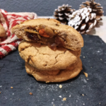 Half a cookie on top of two other cookies