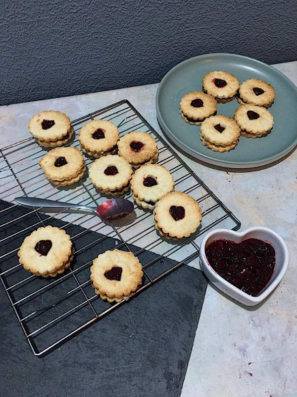 flatlay of biscuits with bowl of jam